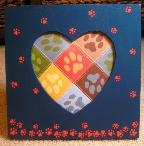 "approx. 7.75"" x 7.75"" wood photo frame, heart opening is approx. 4"" x 5""; hand-painted using Martha Stewart craft paints, sealed with Delta Ceramcoat navy with orange paws"